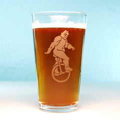 sasquatch unicycle pint glasses