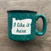 "Forest Green Oregon ceramic camp mug with ""I like it here"" sandblasted"
