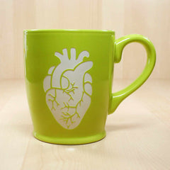 green anatomical heart mug