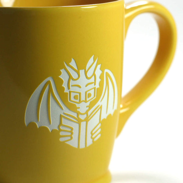 yellow gold book dragon mug, detail