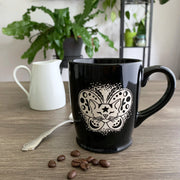 Moth Cat black standard mug by Bread and Badger