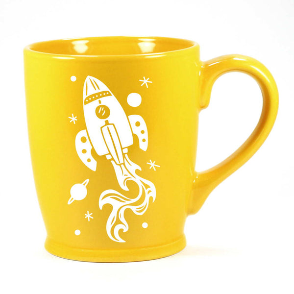 yellow rocket ship mug