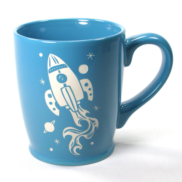 sky blue rocket ship coffee mug