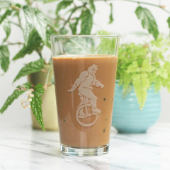 Sasquatch unicycle pint glass by Bread and Badger