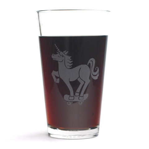 Unicorn skateboarder pint glass by Bread and Badger