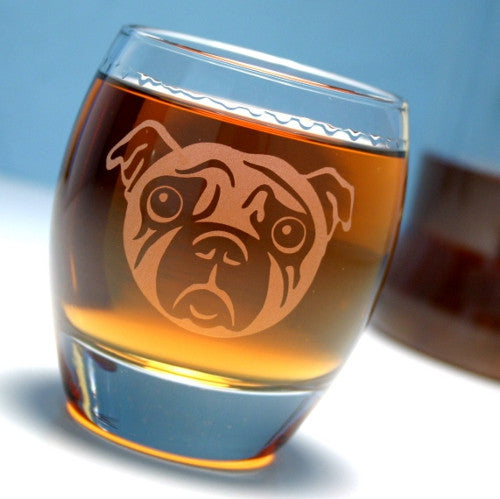 sad pug dog rocks glass