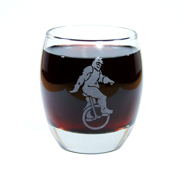sasquatch on a unicycle rocks glass