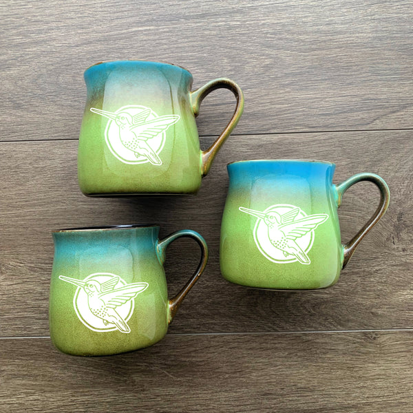 Hummingbird rustic mug in meadow blue green