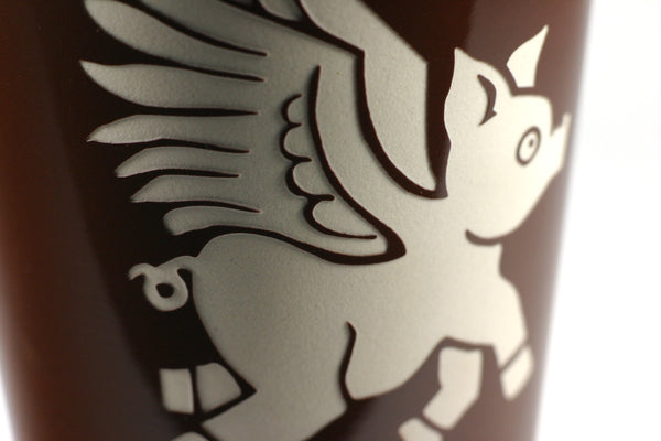 flying pig travel mug detail, brown