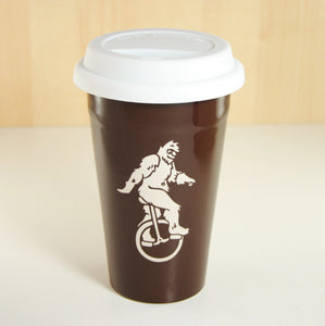 unicycle yeti brown travel mug