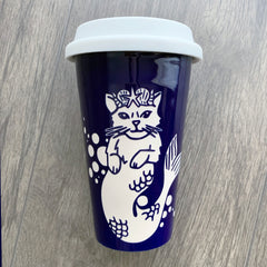 Mermaid Cat navy blue travel mug by Bread and Badger