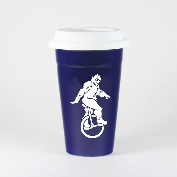 Navy Blue Sasquatch travel mug by Bread and Badger