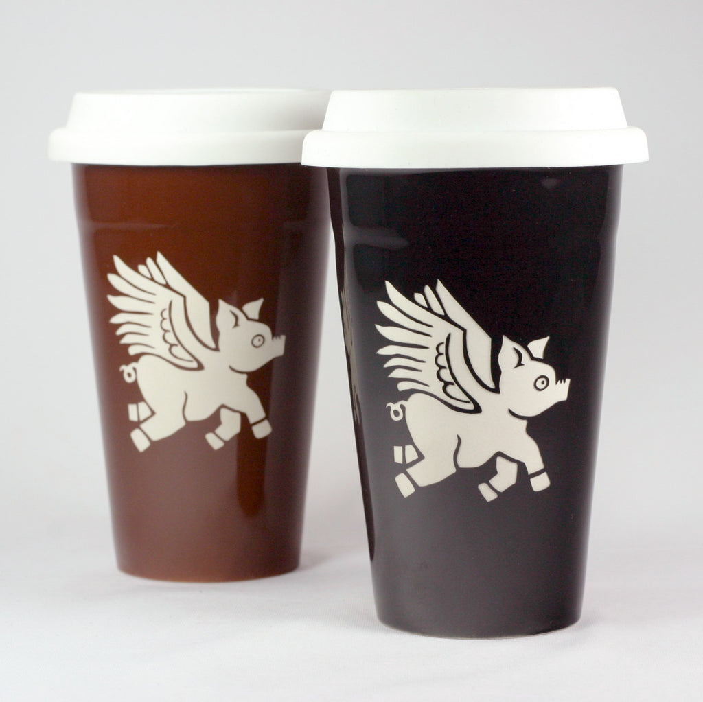 2 winged pig ceramic travel mugs