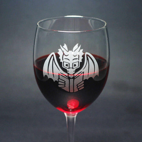 Book Dragon reading wine glass