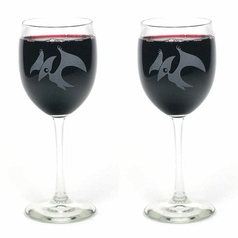 2 pterdactyl dinosaur etched wine glasses