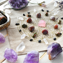 Circular Crystal Grid on geometric flower of life using amethyst, rose quartz, clear quartz in inviting setting