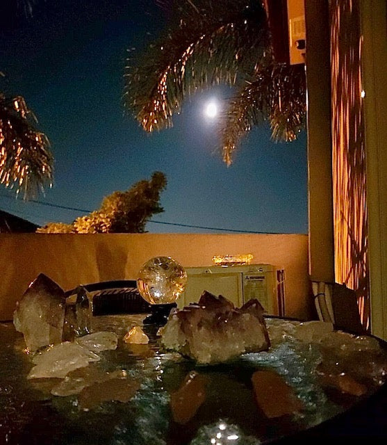 Full moon ritual with crystals lay down by the moonlight left overnight to charge with the powerful and almighty energy of the moon