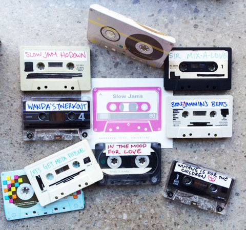 Various cassette tapes as part of the art installation window merchandising labelled 'Slow Jams Ho Down' ' Let's Get Meta Physical' 'In the Mood for Love' 'Wu-Tang is for the Children' ' Ben Jammin's Beats' 'Sir Mix-a-Love' and a greeting card with a cassette tape screenprinted