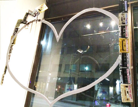 The window display as bare bones... A foam-core heart-shape as the foundation is suspended from the ceiling