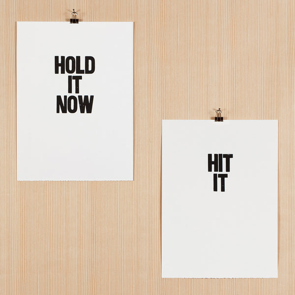 "Letterpress poster pair with the sayings ""Hold it now"" and ""Hit it"""