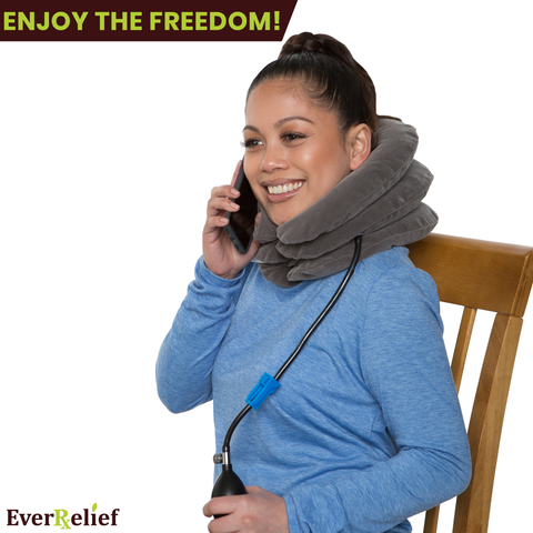 A woman with pain in her neck, back, or shoulder, pinched nerves, soreness, cervical neck spasms, herniated discs and tension in need of neck decompression enjoying the EverRelief Neck traction device.