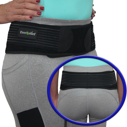 Woman wearing an SI Joint Belt to prevent excessive movement by stabilizing and compressing the hips and pelvic area to reduce nerve inflammation and sciatica pain.