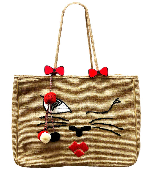 Large woven jute tote bag with winking cat face and tassels