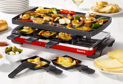 Starfrit THE ROCK Electric Raclette on a set table cooking food