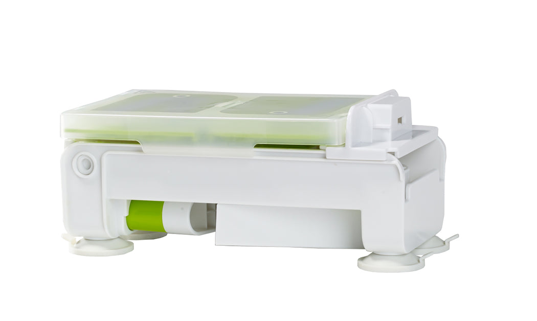 Green and white Starfrit Foldable Spiralizer folded to be stored