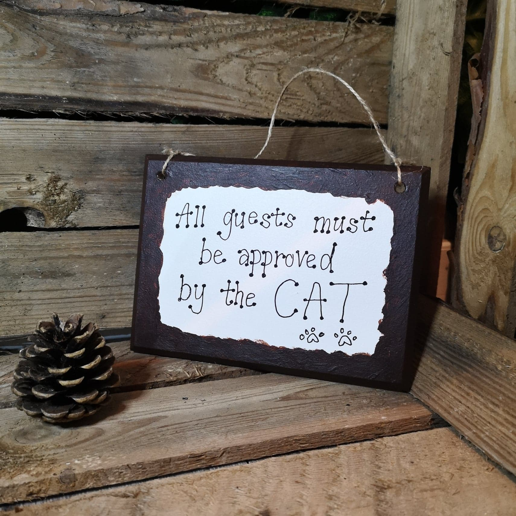 All Guests Must Be Approved by the Cat Plaque
