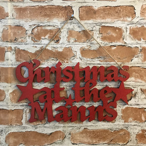 Christmas at the... family name sign
