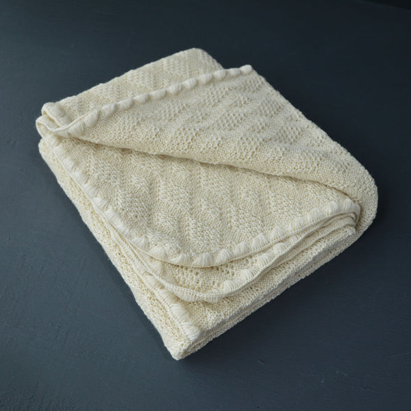 classic knitted wool baby blanket from Disana available with Woollykins