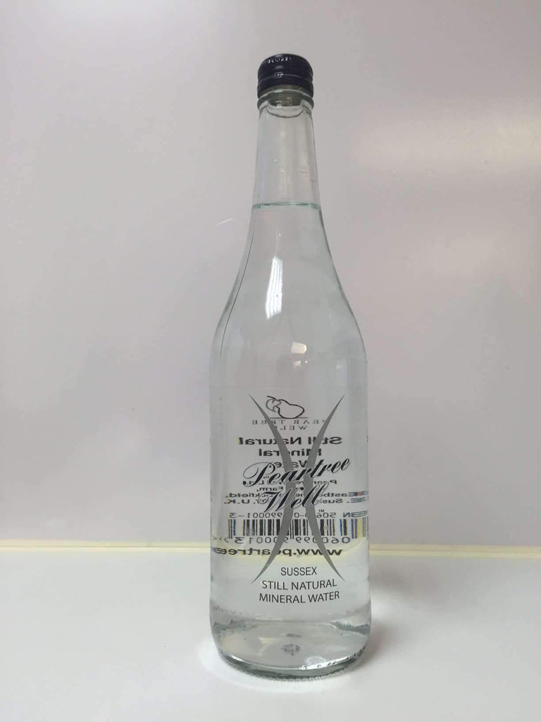 750ml glass bottle of pear tree wells water