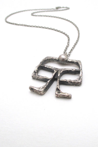 Guy Vidal Canada vintage brutalist pewter openwork on a swing pendant necklace