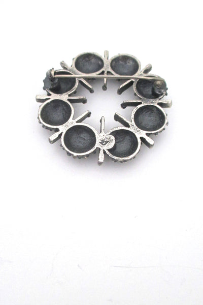 Guy Vidal openwork round pewter brooch