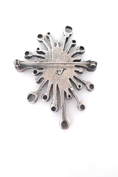 Guy Vidal pewter 'fireworks' brooch