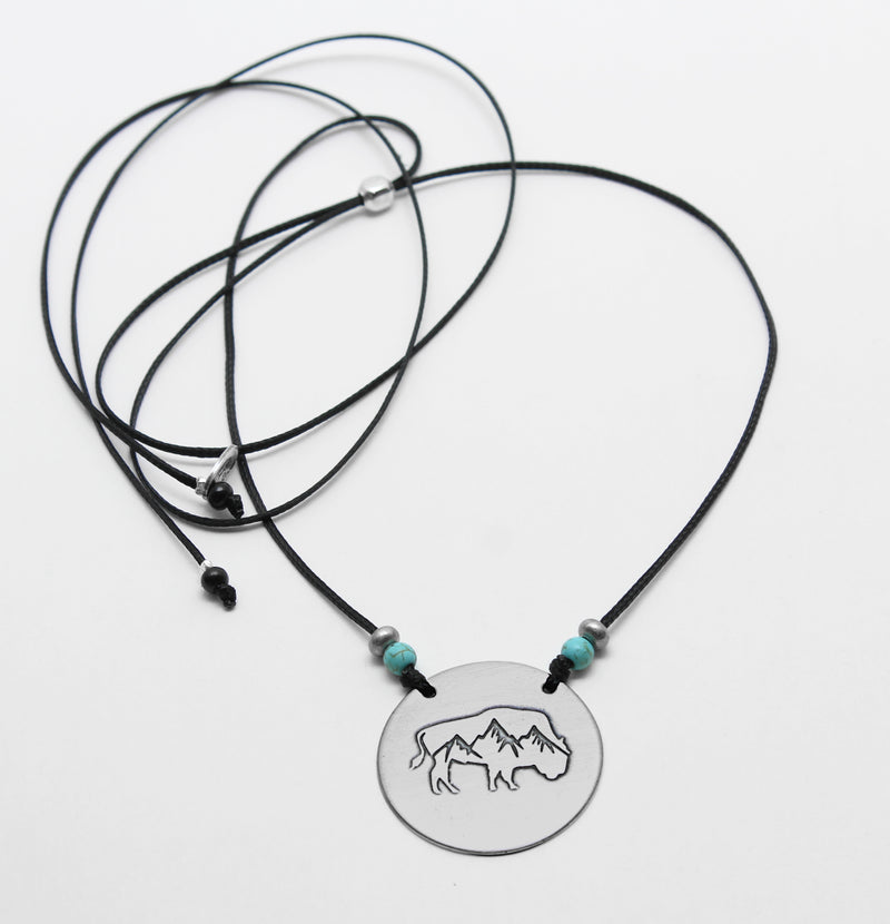 Alpine Buffalo on Disk Necklace, Matte Silver on cord, Daphne Lorna