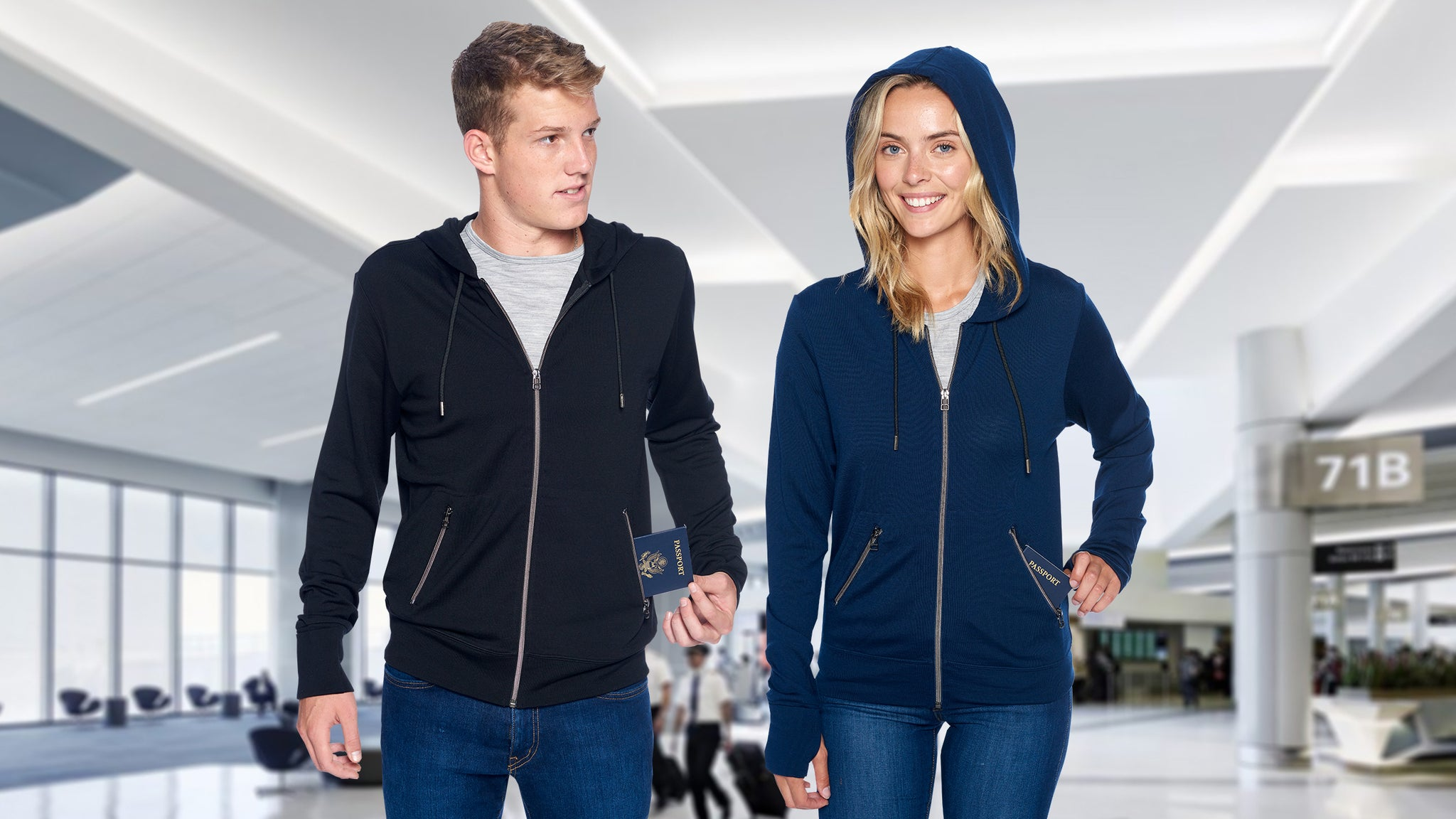 Man and women wearing merino wool hoodies inside a modern airport. He is wearing the Air Dry Merino Wool Hoodie in Black and she is wearing the Air Dry Merino Wool Hoodie in Navy Blue.