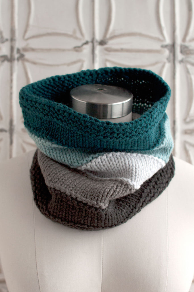 garter stitch knitting and the purl stitch make up this easy knitted cowl in five colors