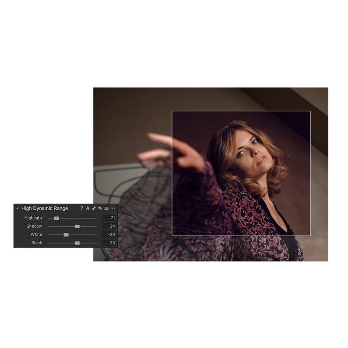 The Capture One Pro 20 High Dynamic Range editor perfecting an image of a model wearing a floral burgundy blouse. There is a stark difference in the before and after square.