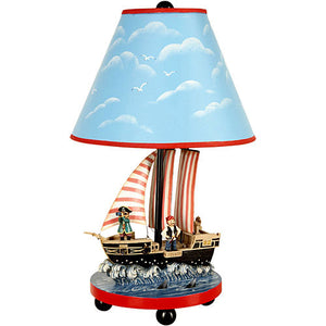 ahoy matey lamp shown with blue sky lamp shade trimmed with red showing pirate ship with pirates for base