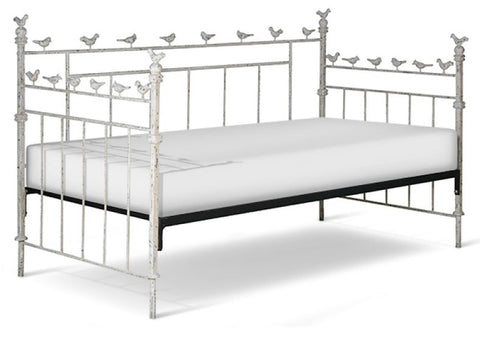 vintage bird daybed shows perimeter of daybed with birds on top railing