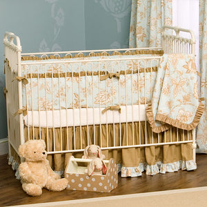 helena iron crib shown with blue and brown bedding featured in antique white