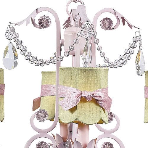 close up of green drum shade with pink sash