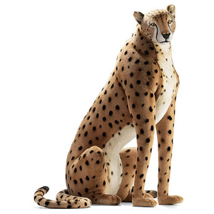 cooper the cheetah is shown in tan with black spots and tail with white chest