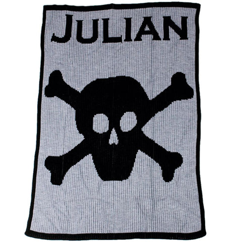 julian cashmere blanket shown in heather gray with font and skull and bones and border in black