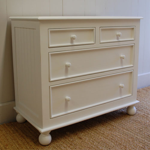beach beaded four drawer dresser shown in white with wooden knobs