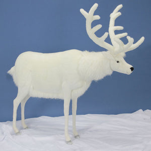 rosie the reindeer (side profile) shown on white snow with fur in winter white with black eyes and nose with large white antlers