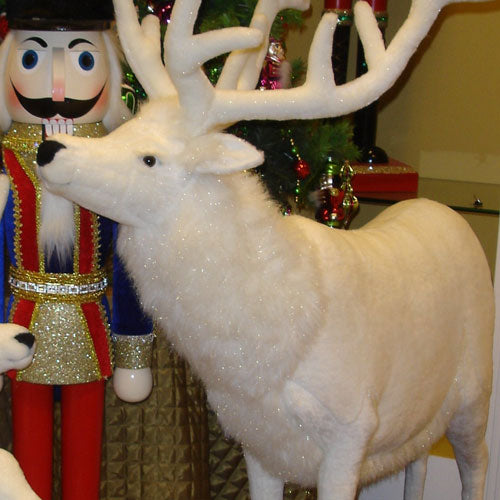 a close up of the front of rosie the reindeer's body in winter white plush with large white antlers