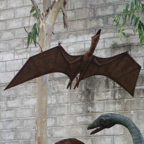 percy the pterodactyl is shown hanging from a tree in brown with it's wings spread out